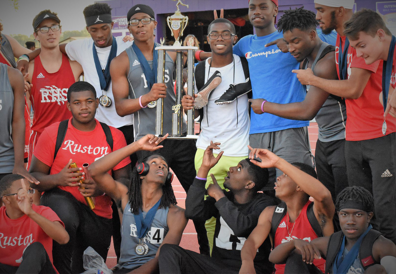 Cam Murphy and the RHS track and field team celebrating their regional meet victory just days after the April 25 tornado claimed the lives of Murphy's mother, Kendra Butler, and brother, Remington Butler.
