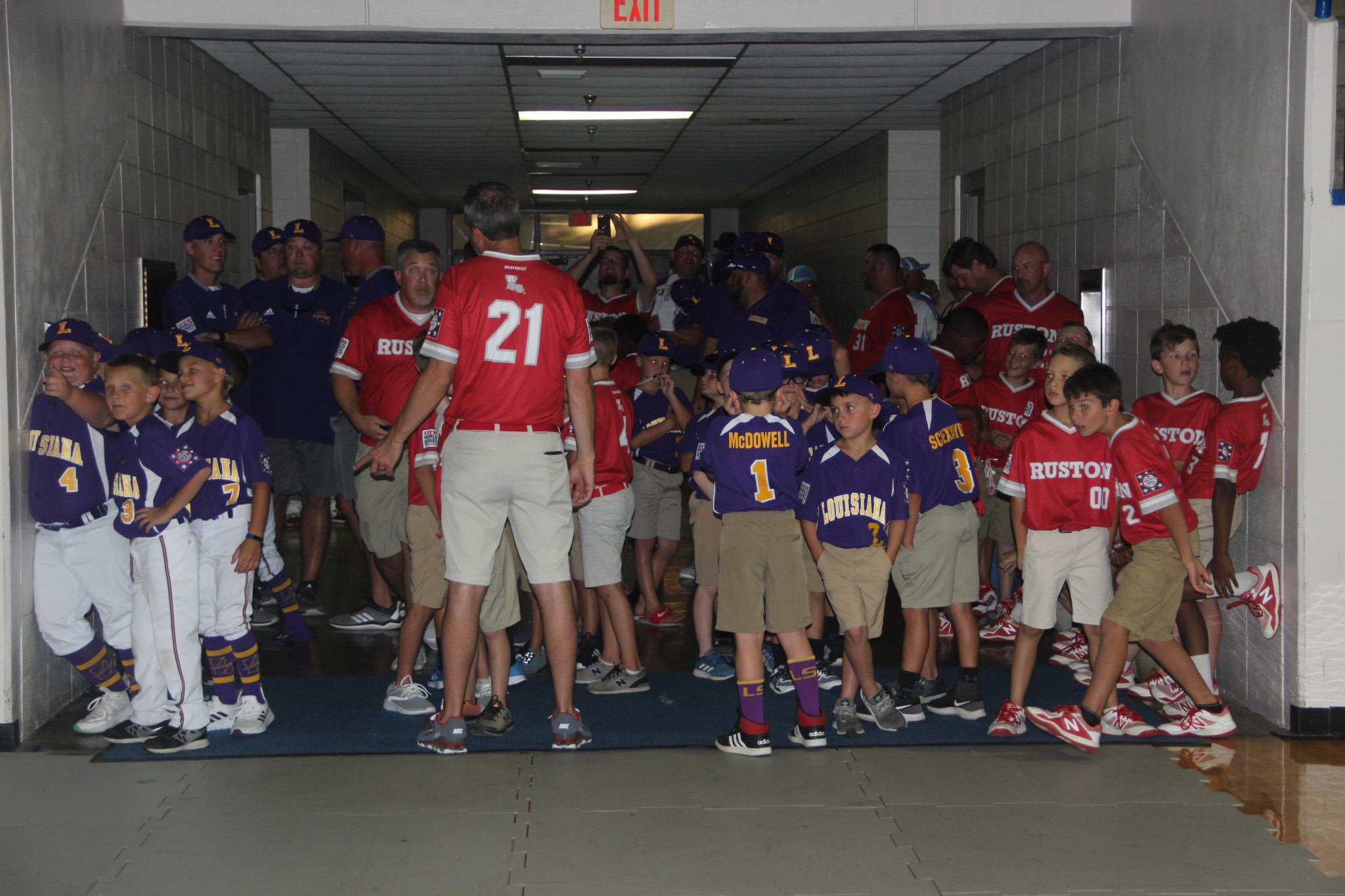 Team Louisiana (wearing purple) and Team Ruston (wearing red) wait for Friday's opening ceremony to begin.
