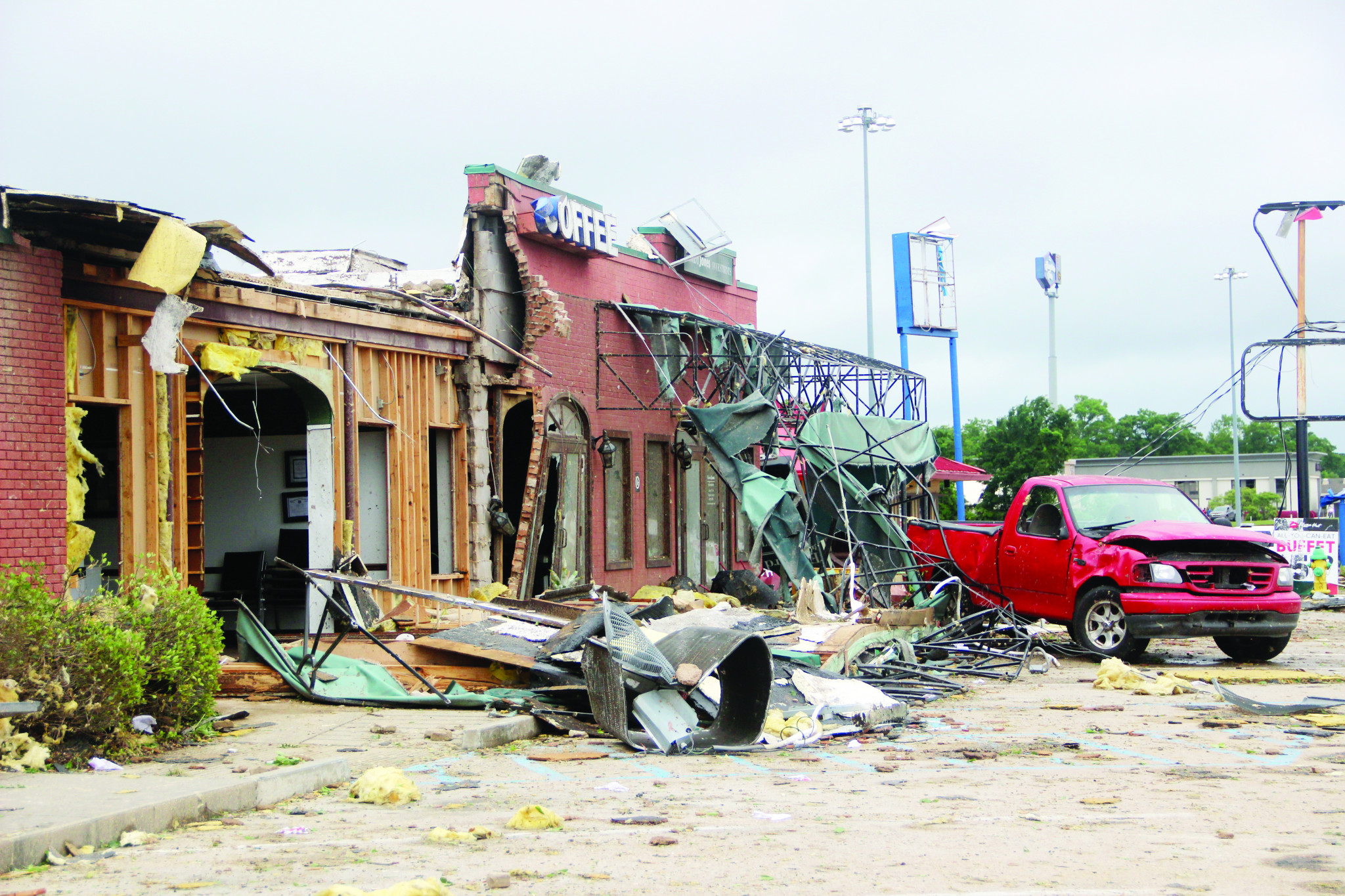 """<span style=""""font-size:12pt""""><span style=""""font-family:&quot;Times New Roman&quot;"""">The destroyed Courtesy Loans, Parish Press and Edward Jones businesses the morning after the tornado.</span></span>"""