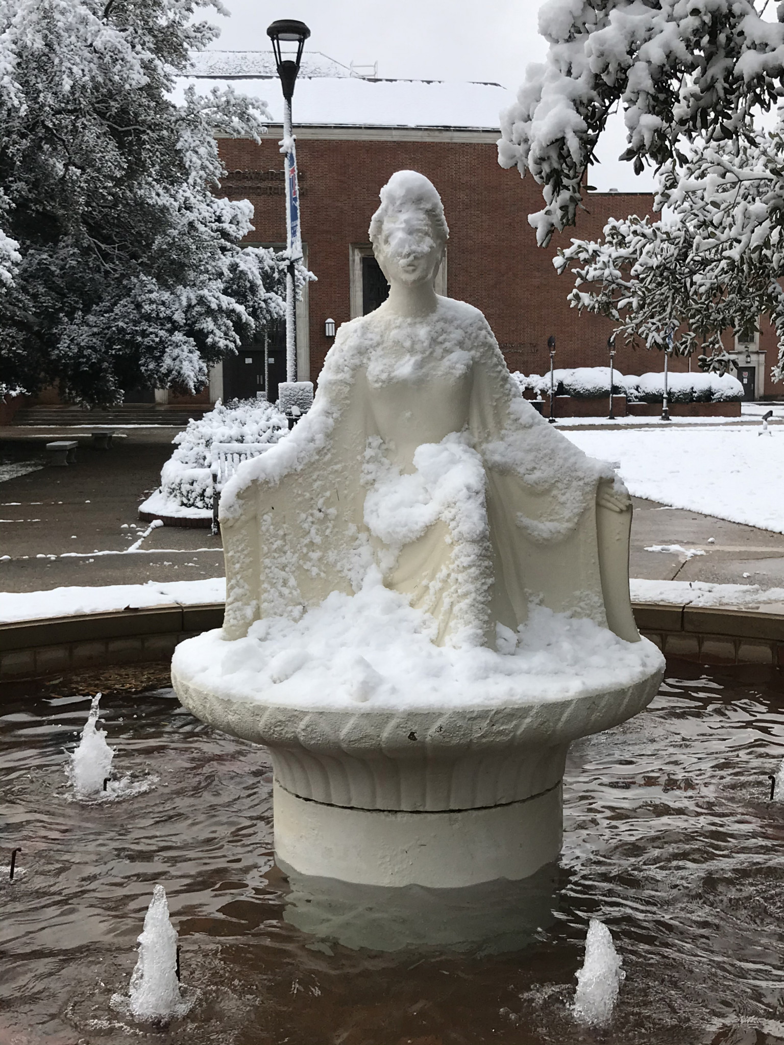 A snow-laden Lady of the Mist on Louisiana Tech campus - Leader photo by Caleb Daniel
