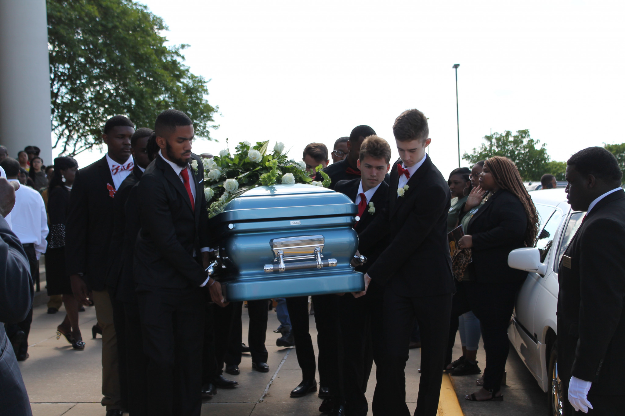 Ruston High School students bearing Remington Butler's casket
