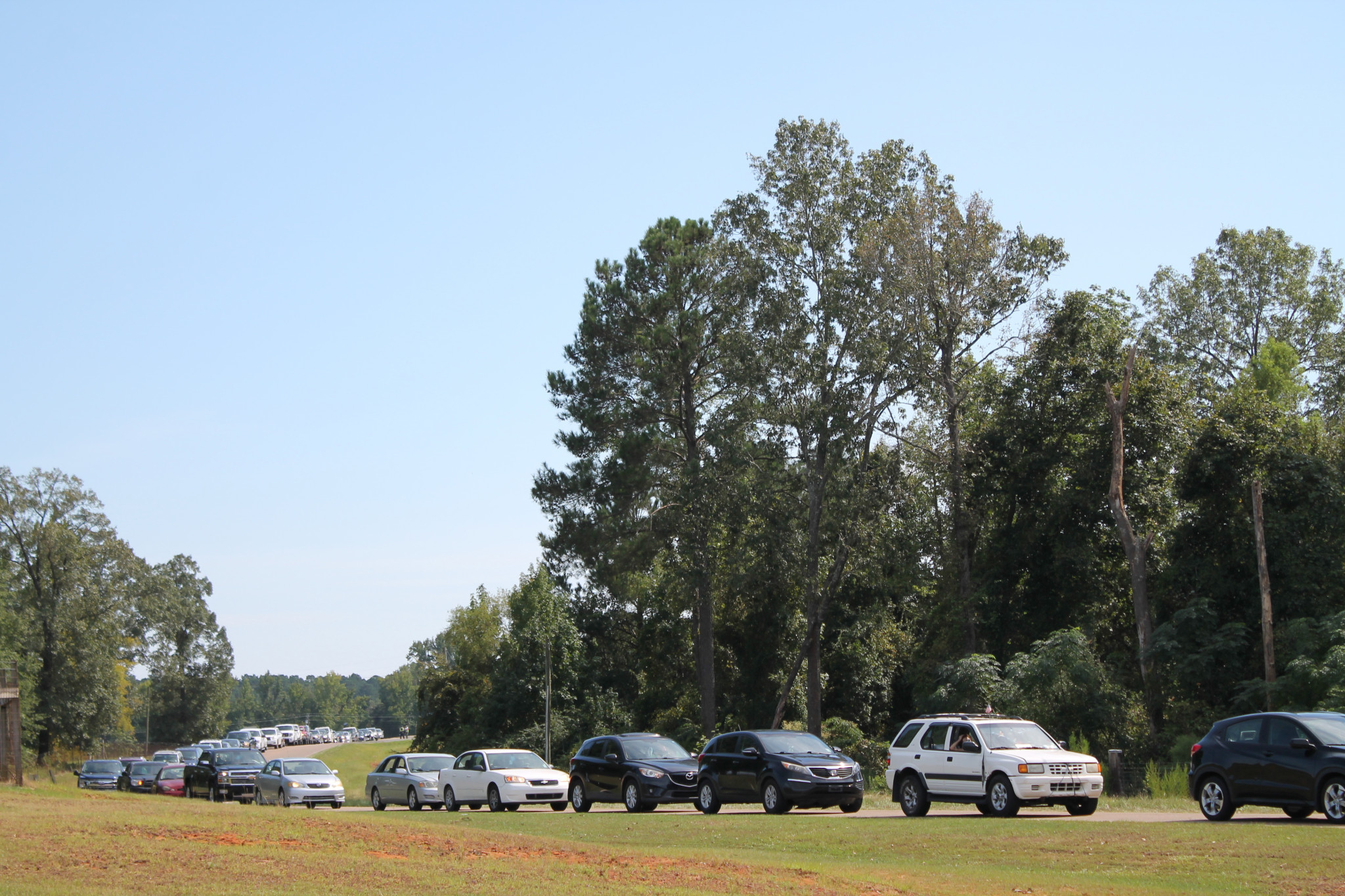 Cars lined up at the Expo Center to reeive food boxes and cases of water handed out by the Louisiana National Guard.