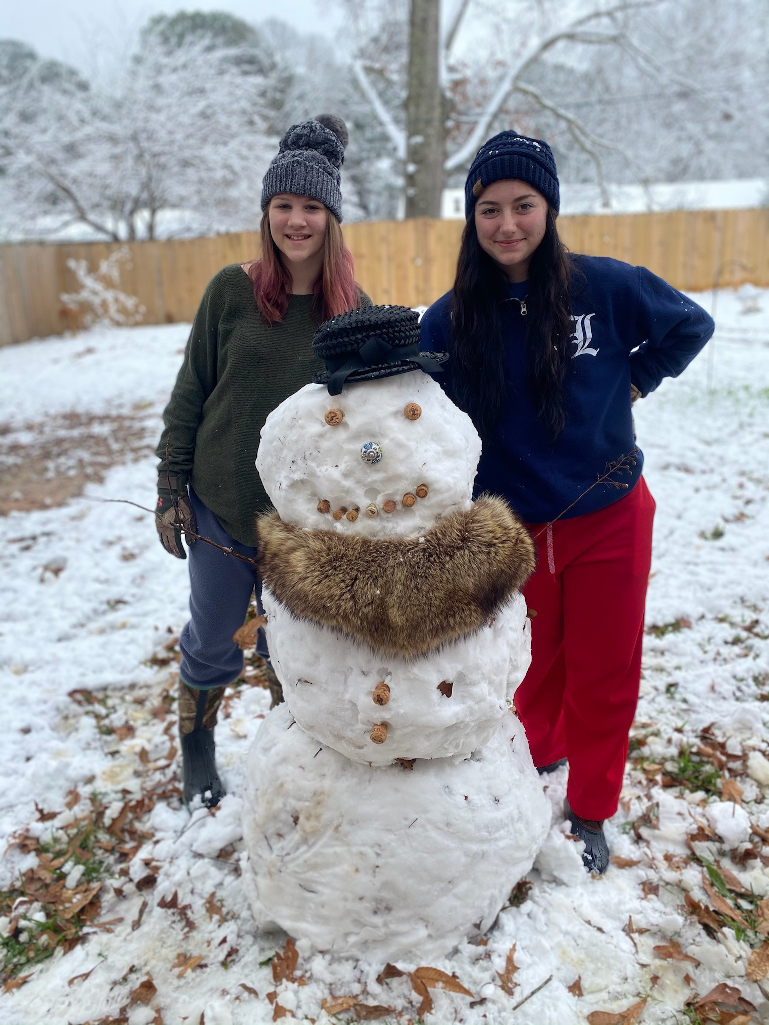 Kaylee and Grace Dotson with Vanessa the snowwoman