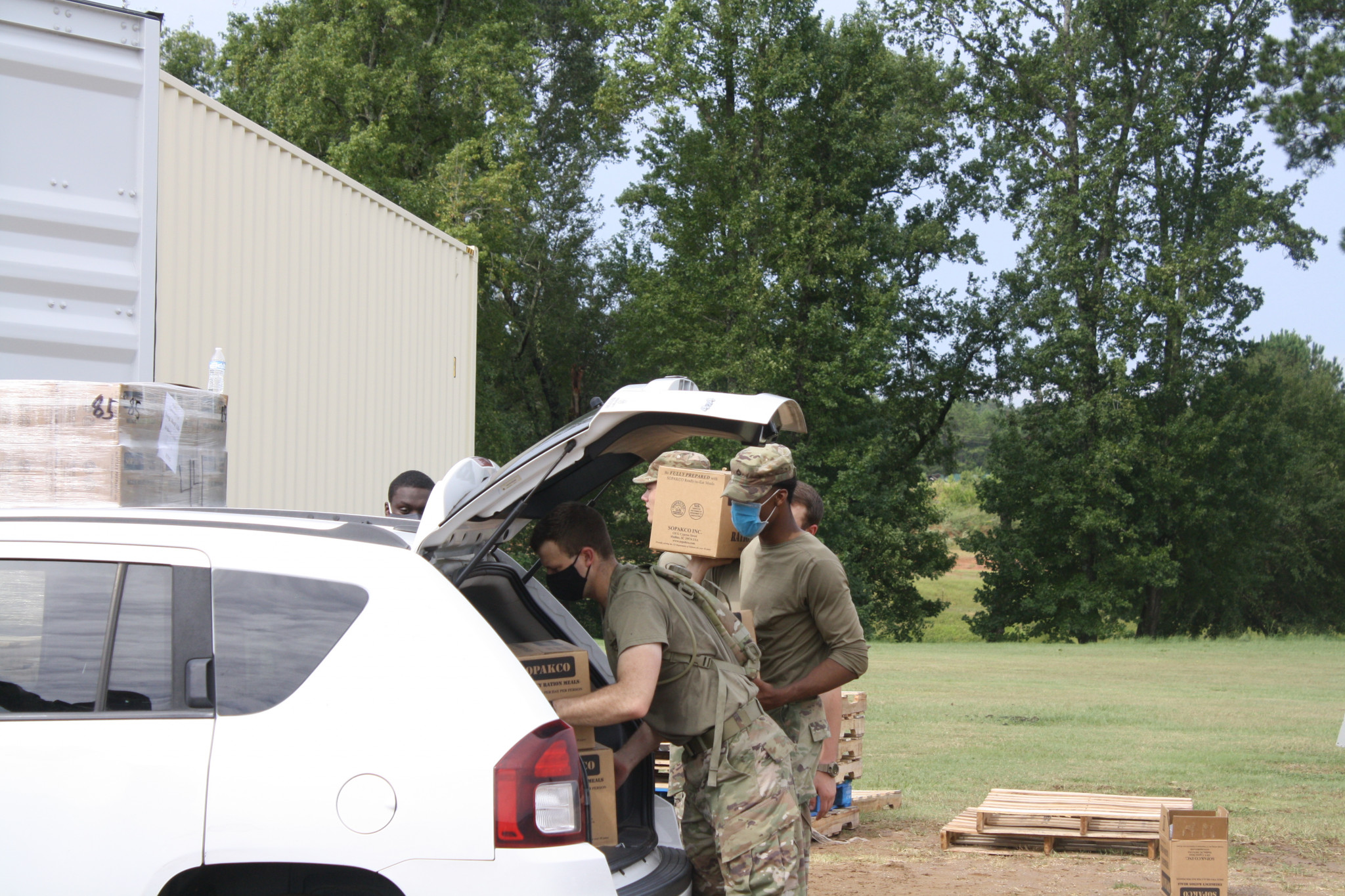 The Louisiana National Guard arrived at the Ruston Exhibition Center on Friday morning with cases of water and boxes of pre-packaged meals. Pictured are guardsmen loading water and boxes of food into cars.
