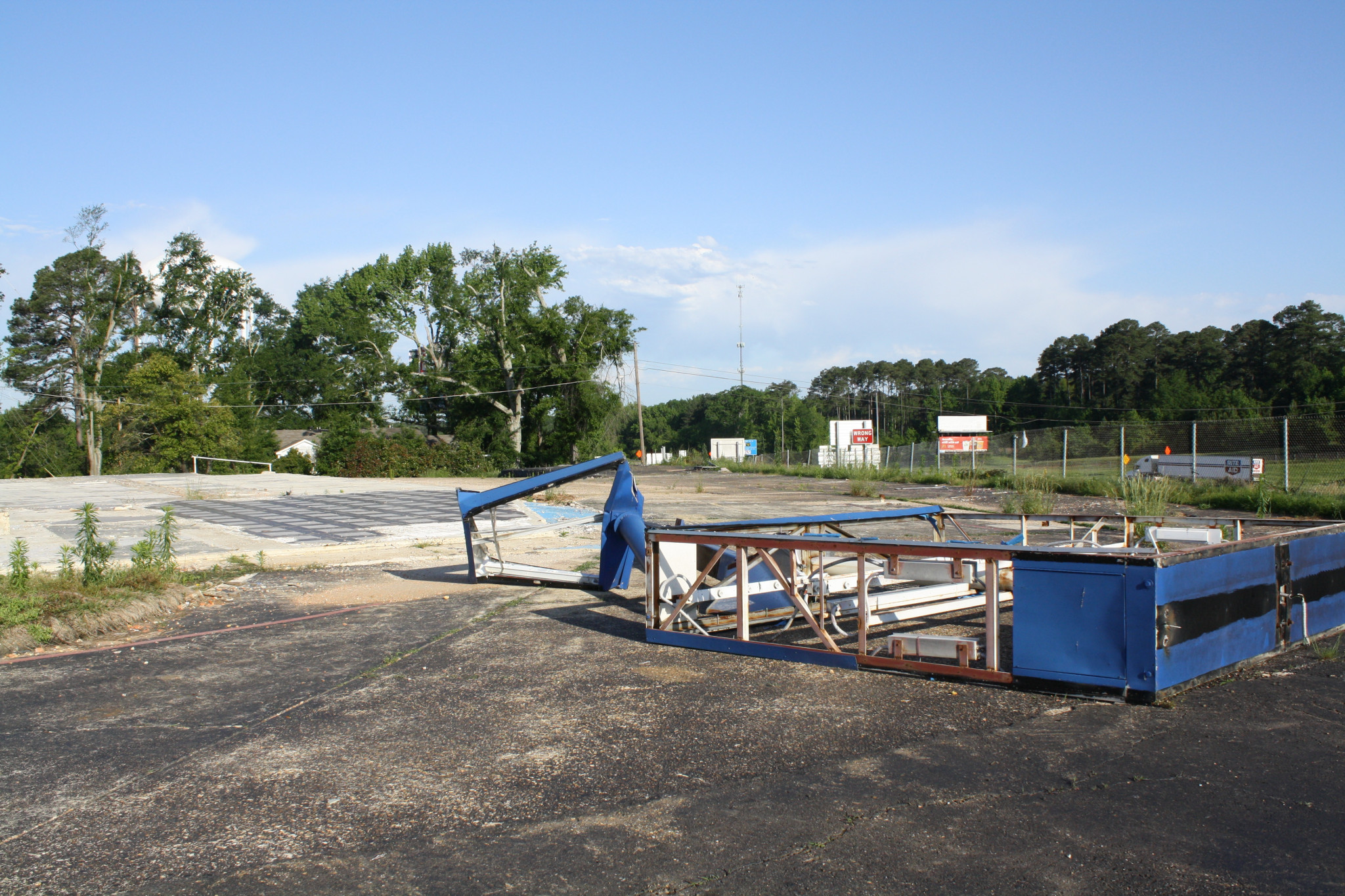 A current view of the remains of the motel: a slab and downed sign.