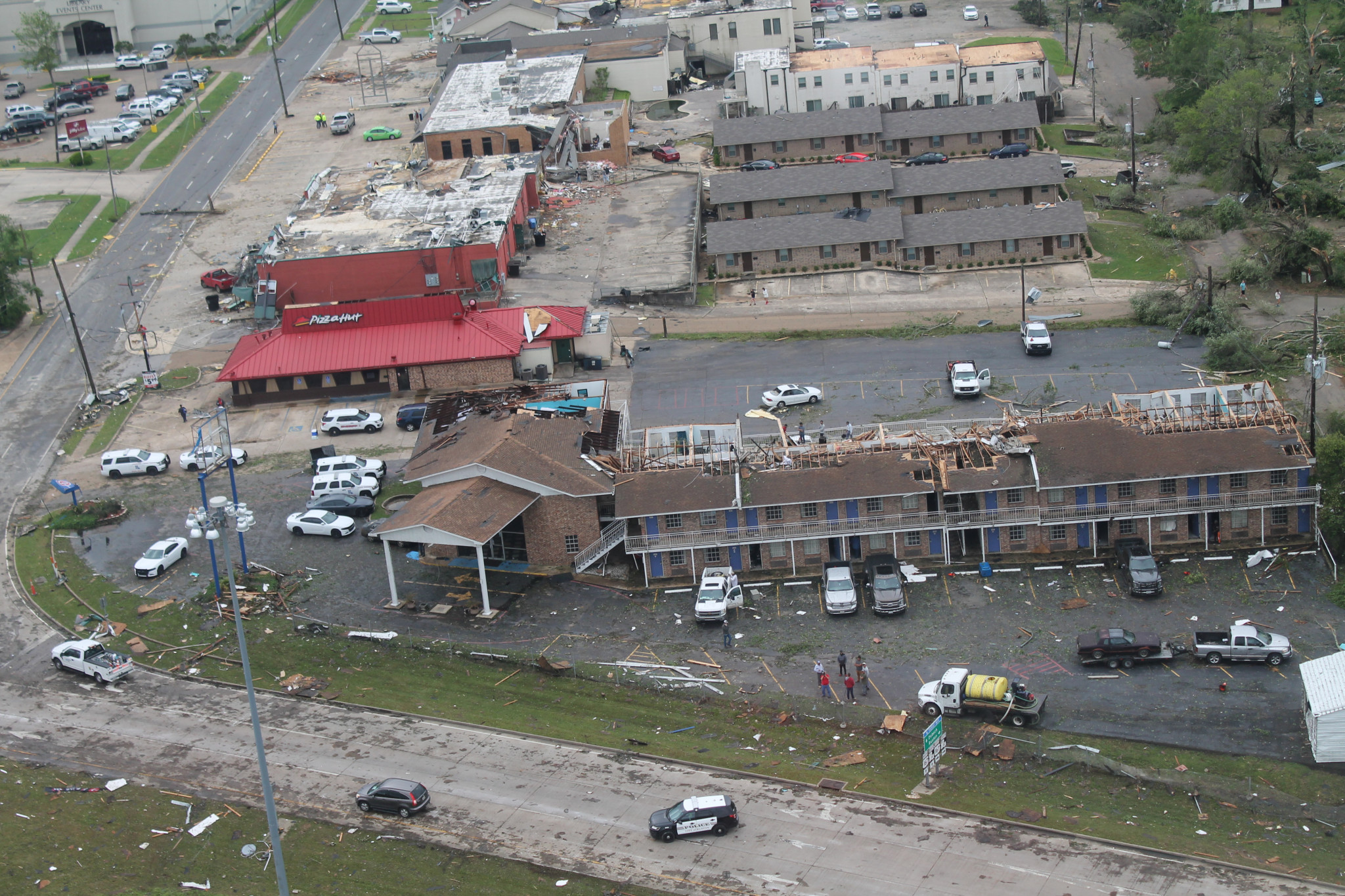 An aerial view of the tornado damage to America's Best Value Inn, Pizza Hut and surrounding buildings last year.