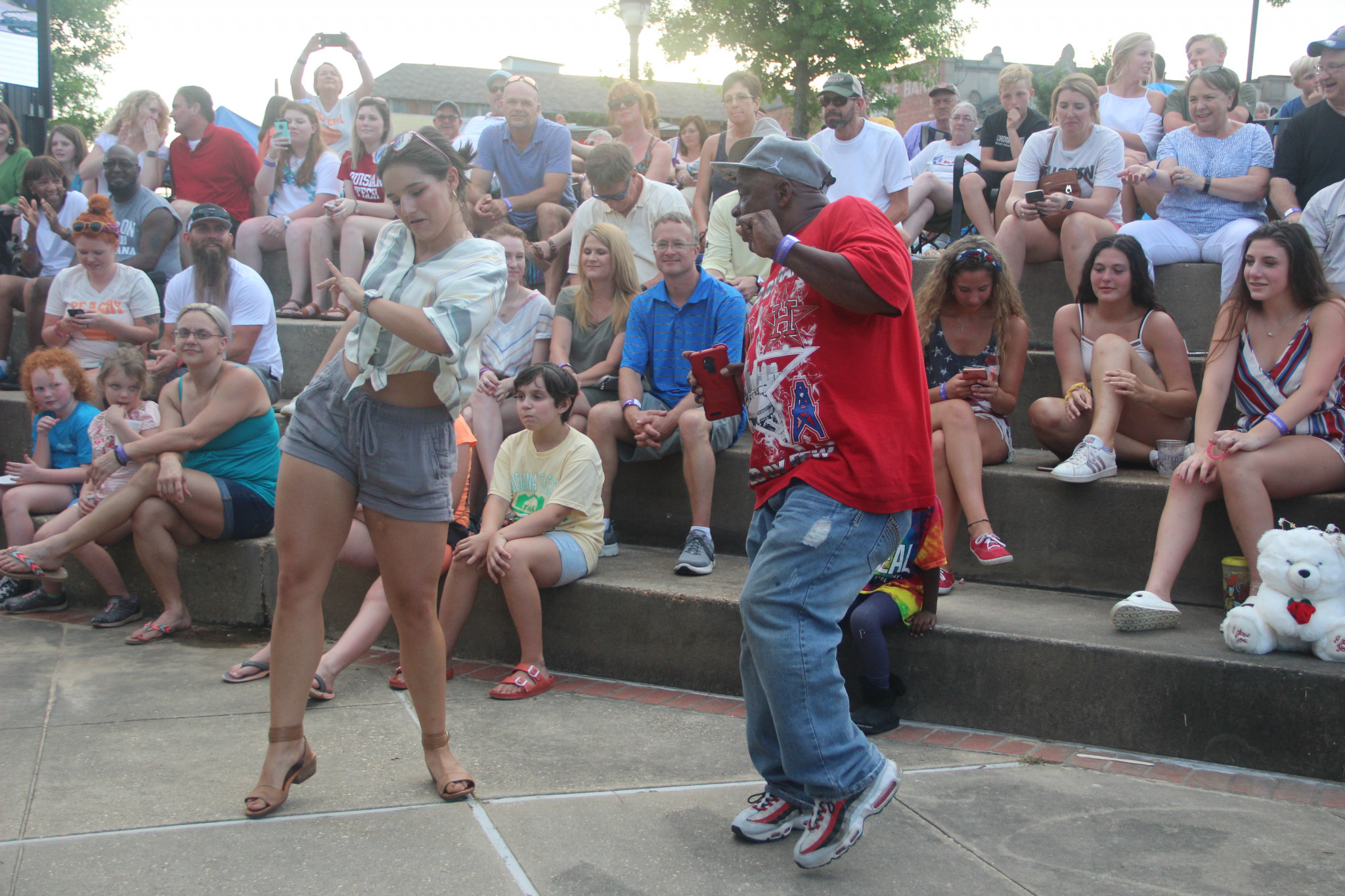 Concertgoers dancing during J.A.M.'s performance