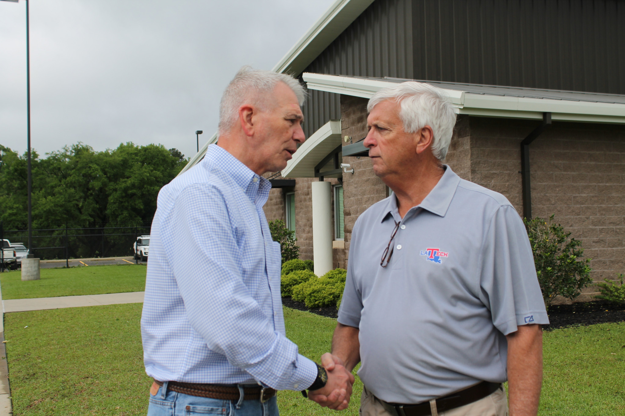 Congressman Ralph Abraham, left, and Walker outside the Emergency Operations Center — April 25
