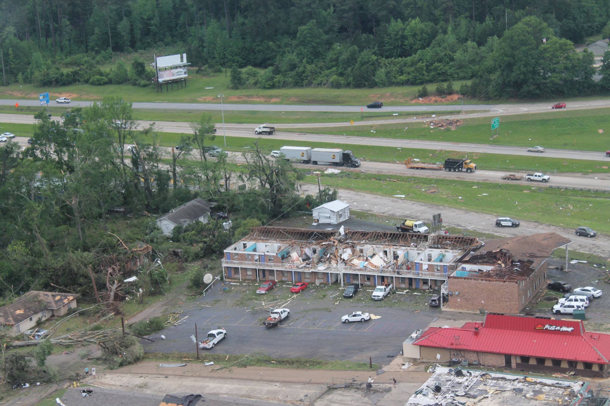 Aerial view of Motel 6 and debris around I-20 — April 25