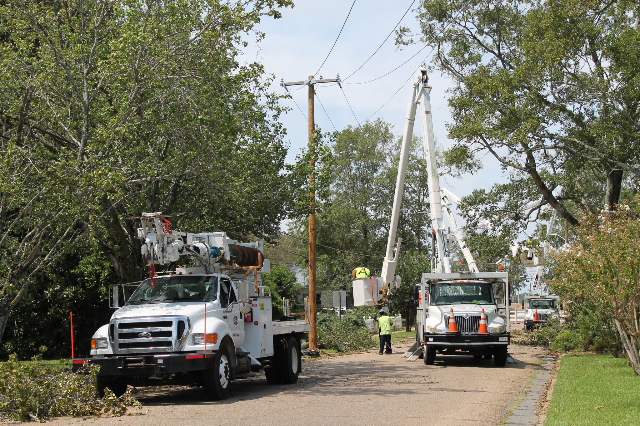 Work trucks tending to downed power lines on East Arizona Avenue
